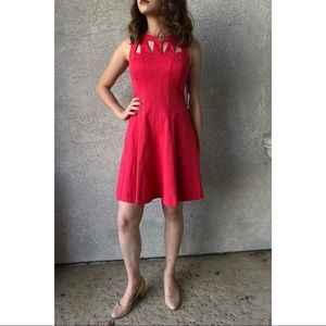Coral colored fit and flair dress